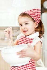 beautiful little girl baking